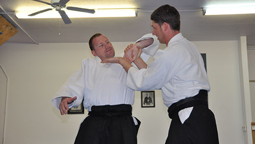 Sensei demonstrating sankyo